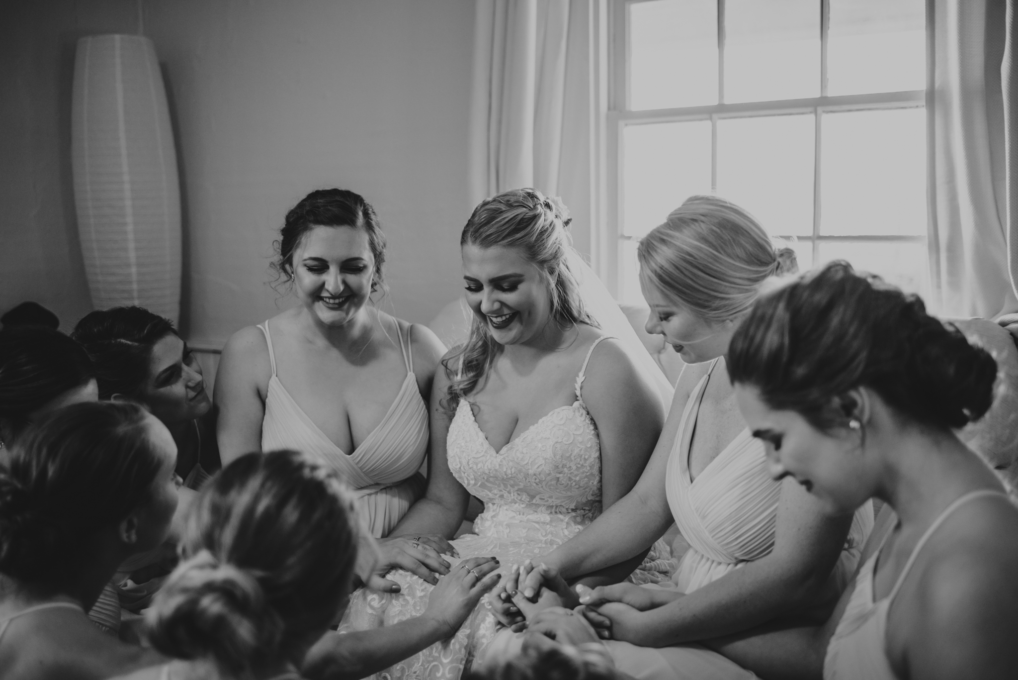 Raleigh-wedding-photographer-bride-praying-with-bridesmaids-warren-estate-rose-trail-images.jpg