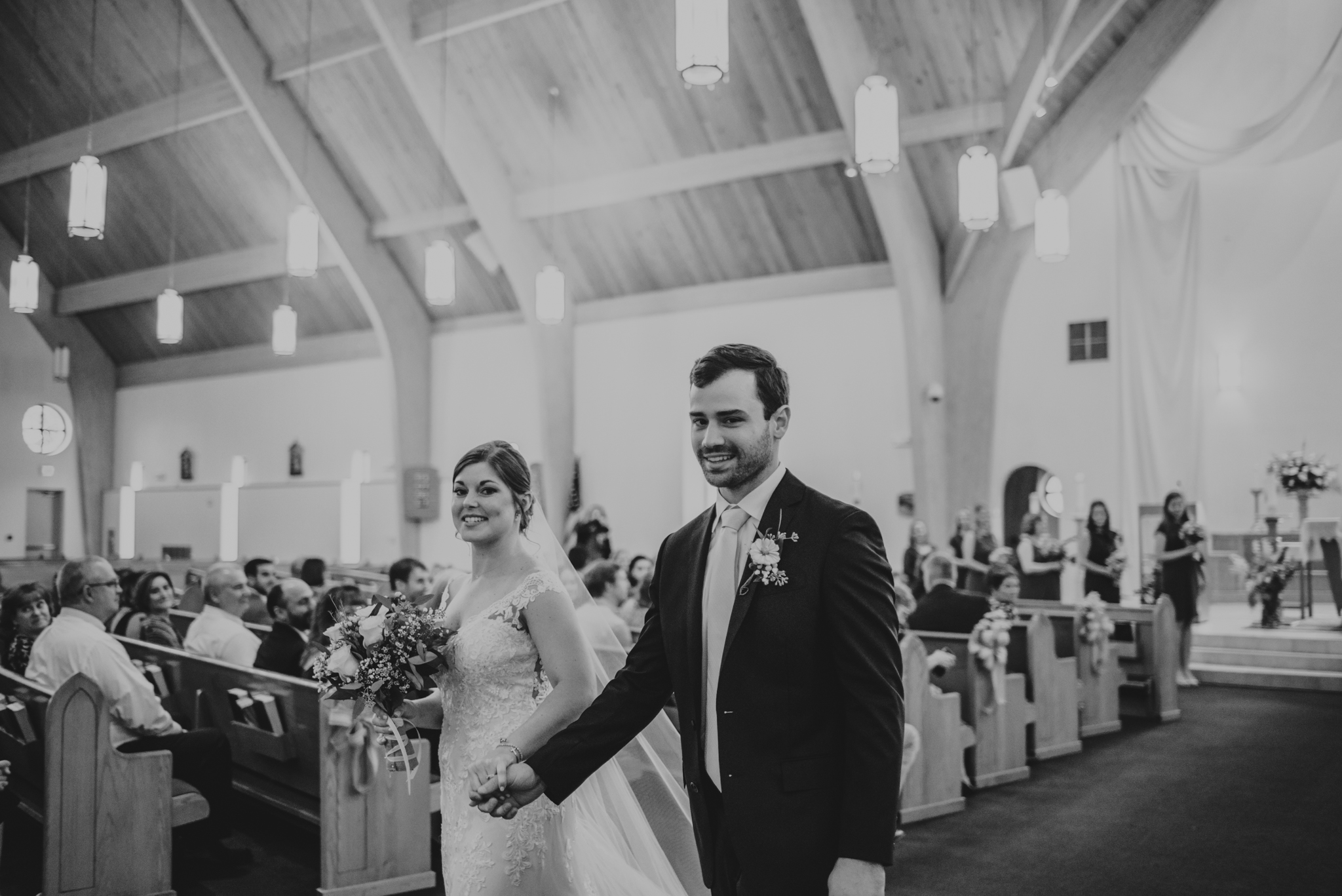 Raleigh-wedding-photographer-bride-and-groom-walk-down-aisle-rose-trail-images.jpg