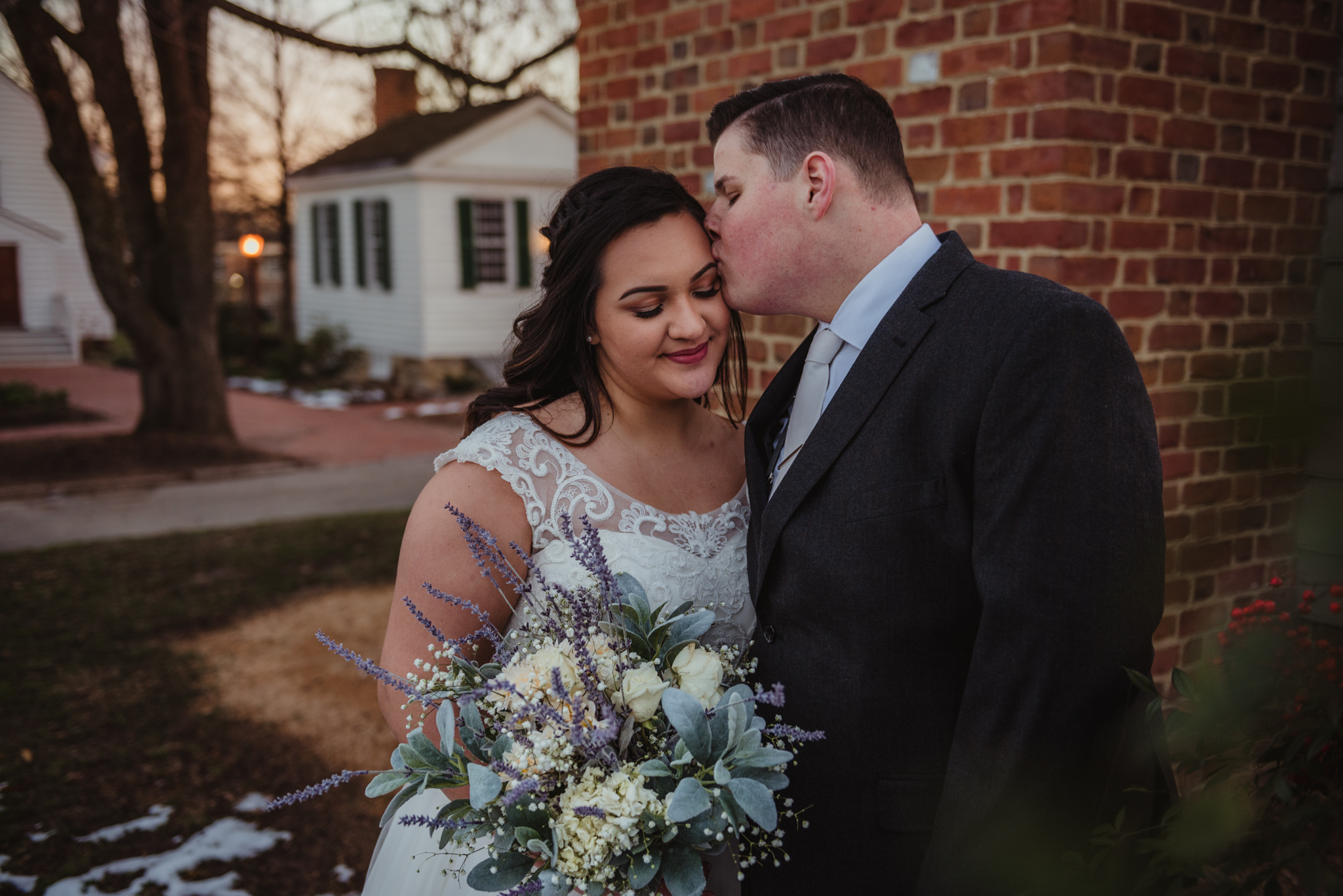 Raleigh-wedding-photographer-bride-and-groom-portraits-in-snow-mordecai-rose-trail-images.jpg