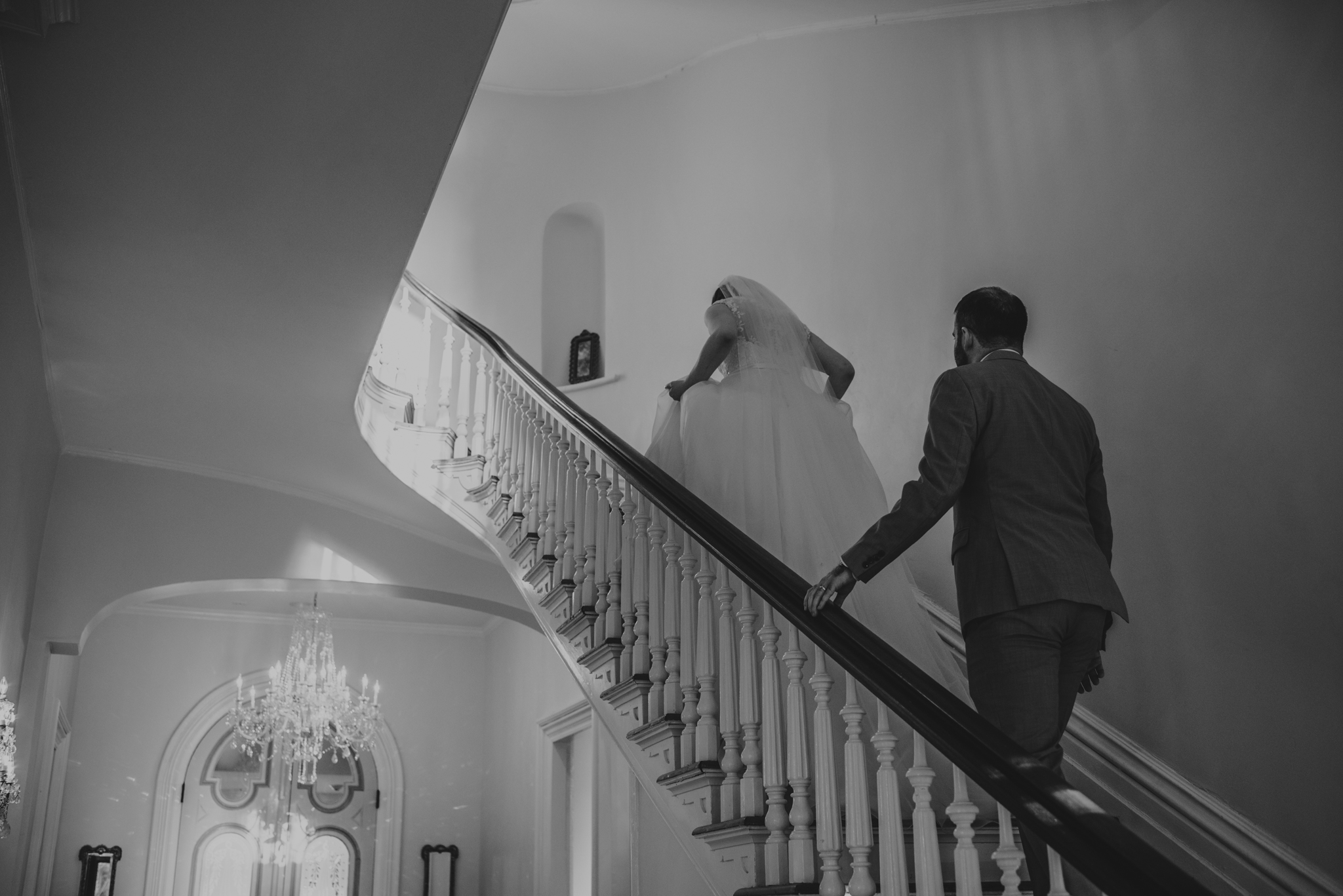 Raleigh-wedding-photographer-bride-and-groom-walk-upstairs-merrimon-wynne-rose-trail-images.jpg