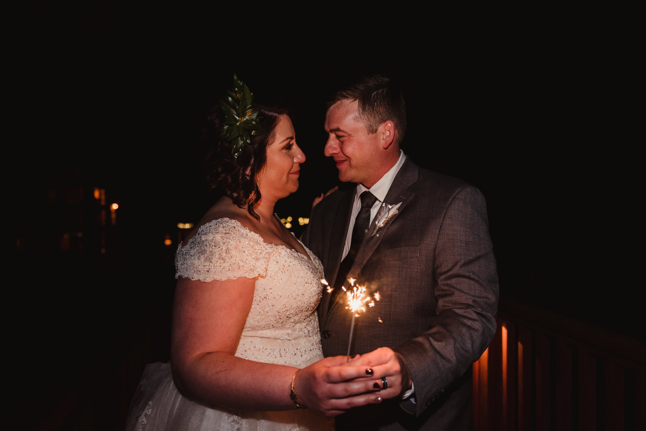 Raleigh-wedding-photographer-bride-and-groom-portraits-sparkler-rose-trail-images.jpg