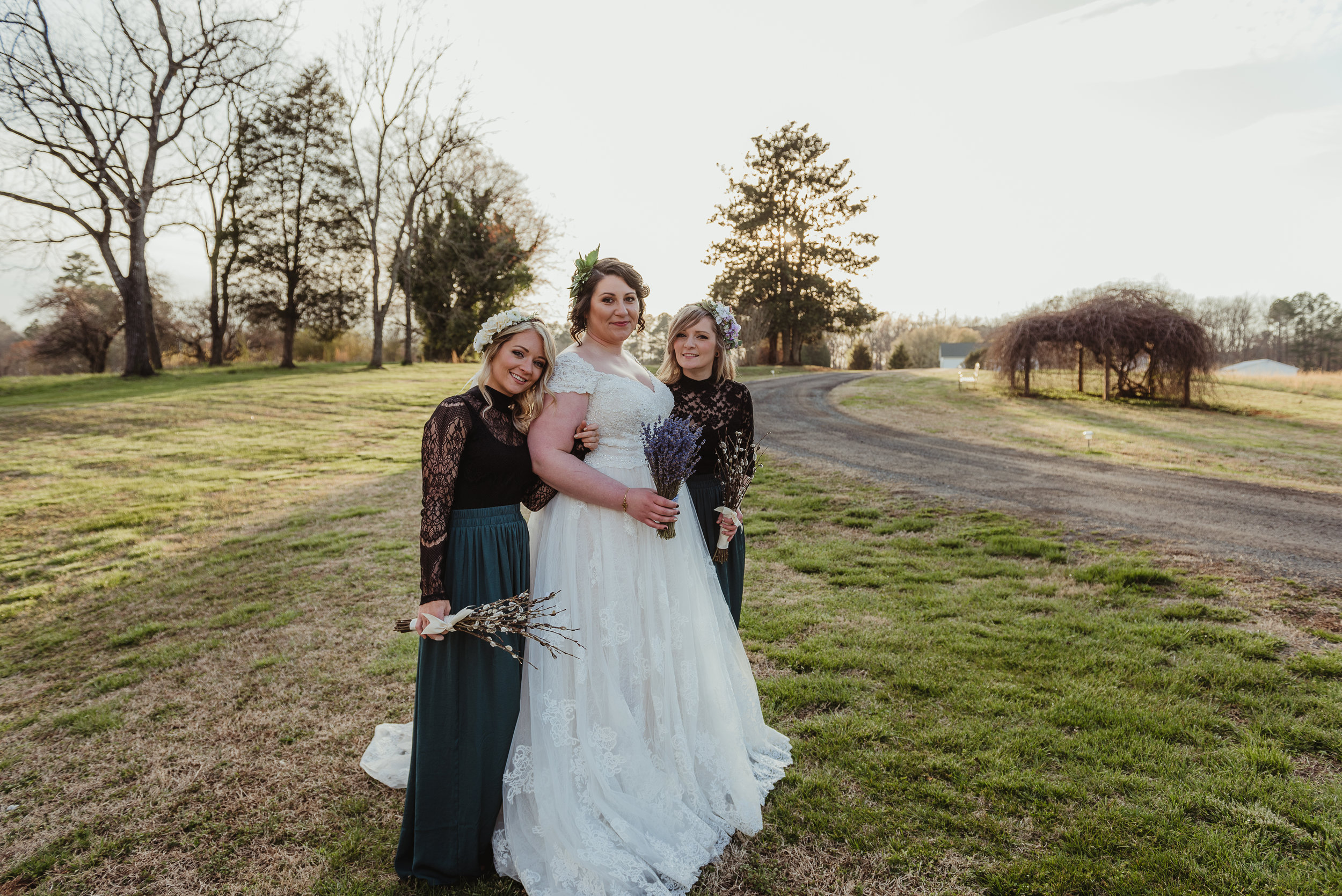 Raleigh-wedding-photographer-bride-and-bridesmaids-barn-at-valhalla-rose-trail-images.jpg