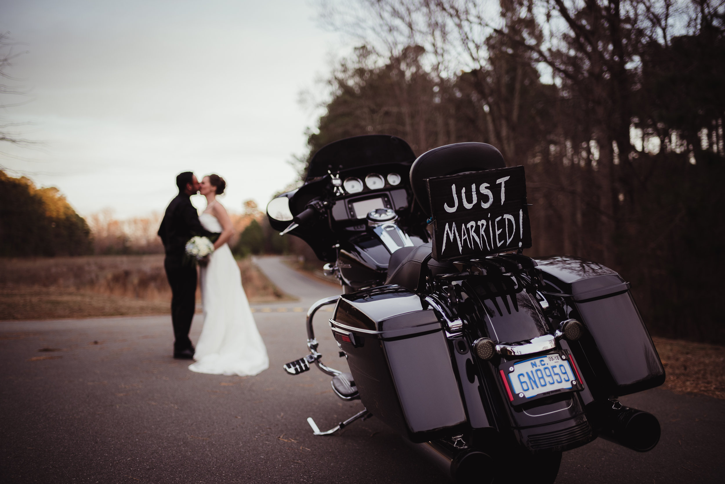 Raleigh-wedding-photographer-bride-and-groom-portraits-motorcycle-rose-trail-images.jpg