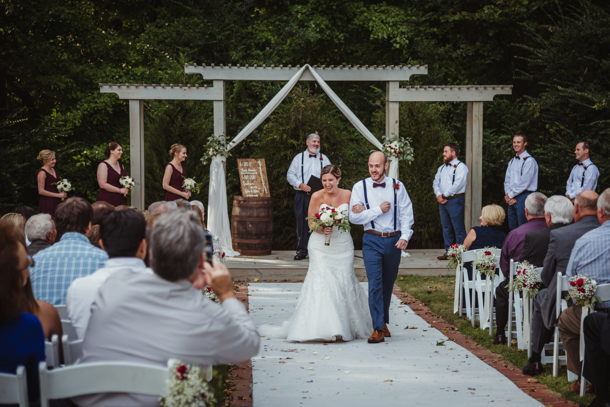 Raleigh-wedding-photographer-bride-and-groom-walk-down-the-aisle-cedar-grove-acres-rose-trail-images.jpg