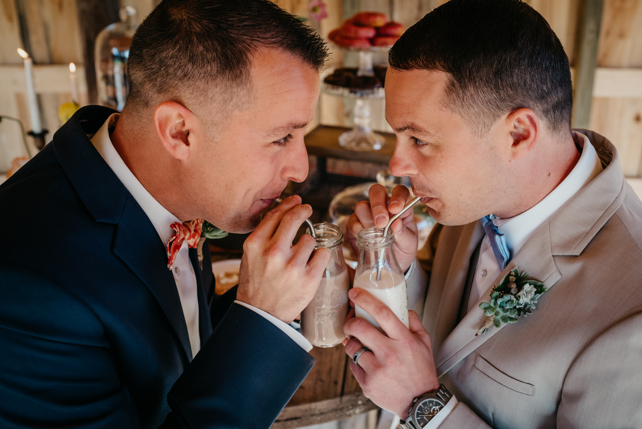 Two-grooms-drink-their-chocolate-milk-at-windy-hill-farm