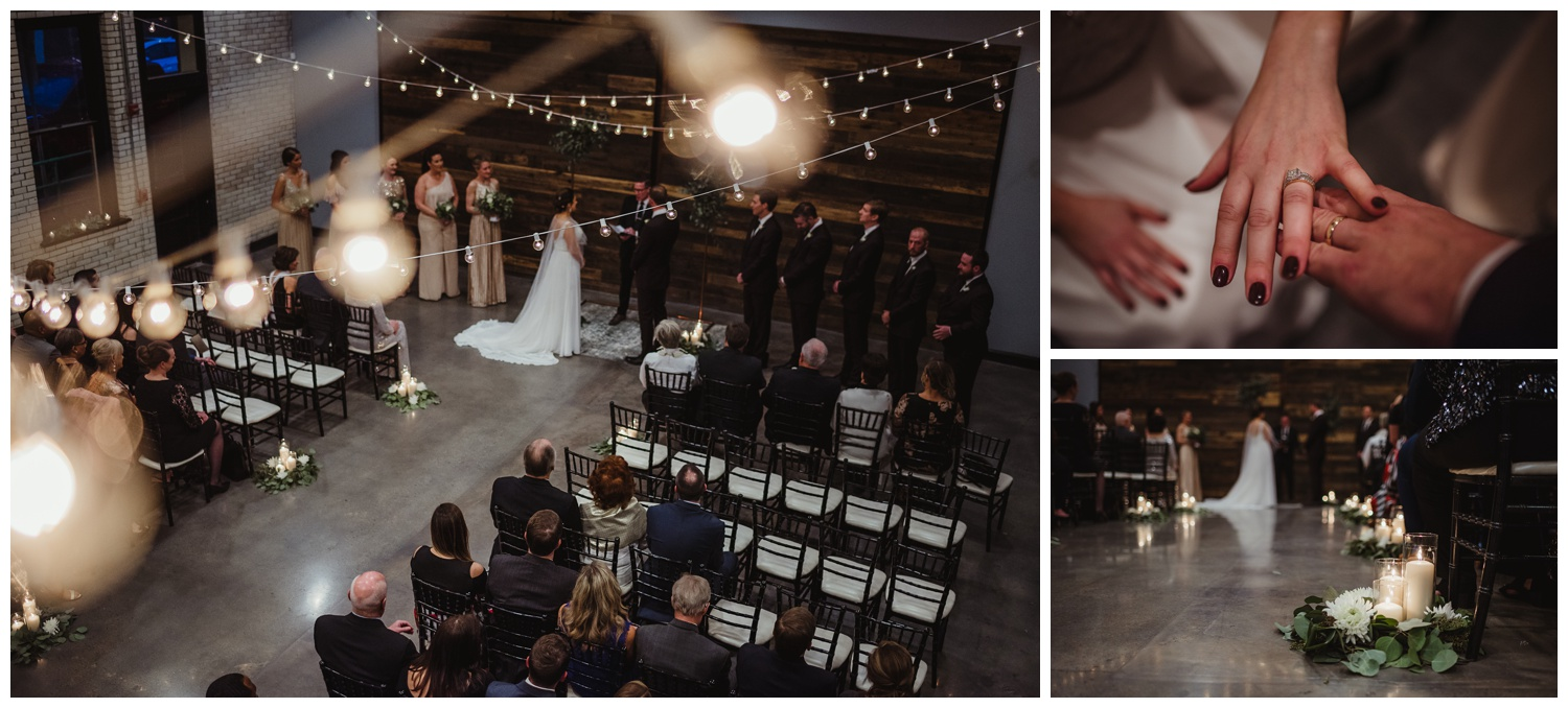 The bride and groom exchange vows under the market lights during their indoor wedding ceremony in downtown Raleigh, photos by Rose Trail Images.