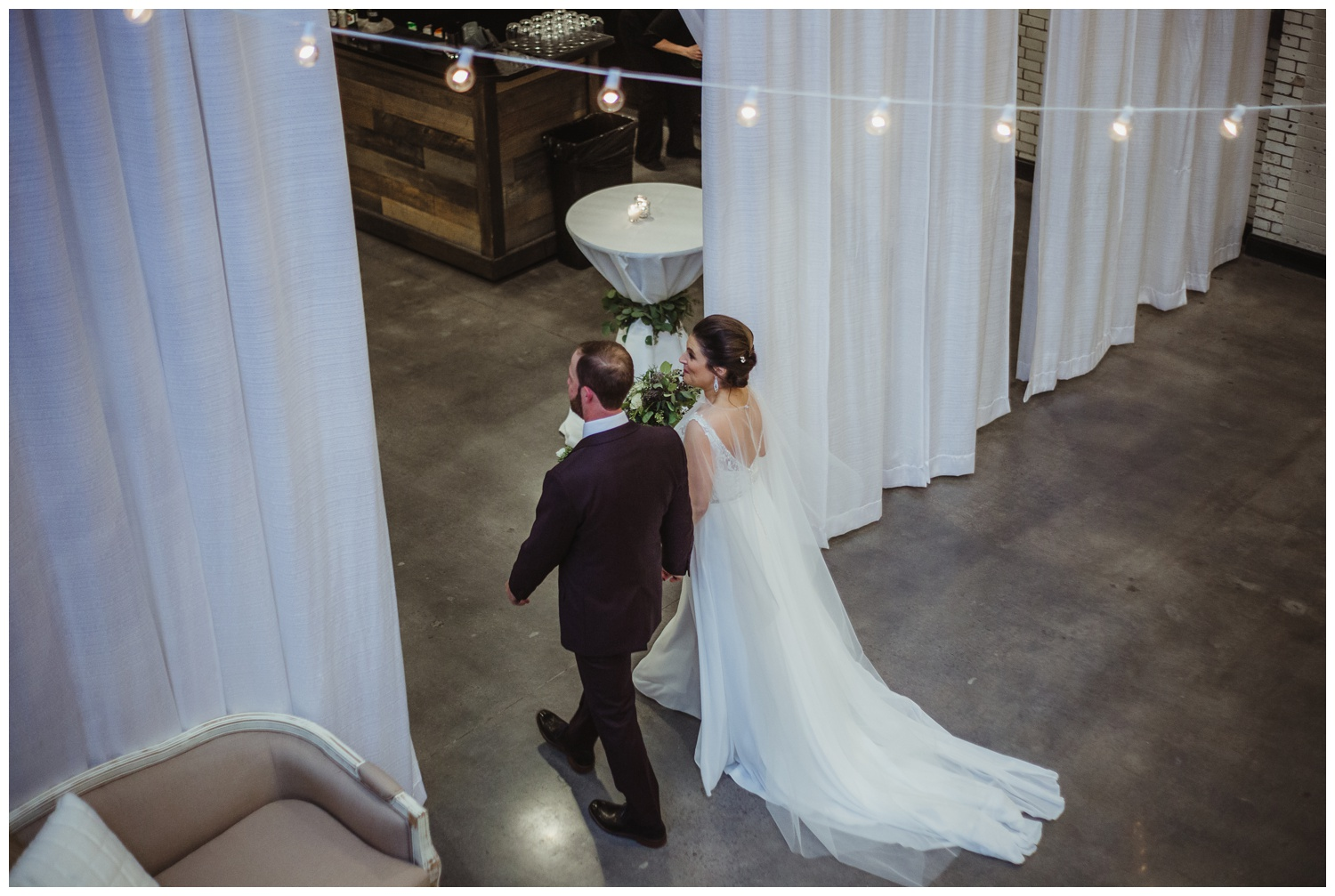 The bride and groom walk down the aisle after they exchanged vows during their indoor wedding ceremony in downtown Raleigh, photos by Rose Trail Images.