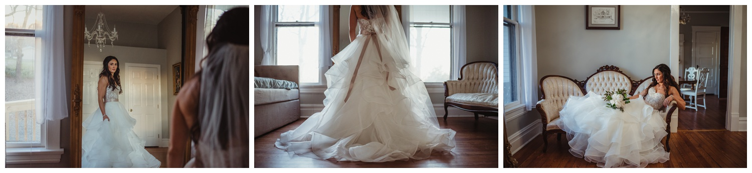 The bride poses in her wedding dress at the Mason Street Manor before her wedding day, pictures by Rose Trail Images.
