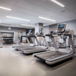 FITNESS   Maintain your exercise routine in our fitness center featuring treadmills, stationary bikes and elliptical machines; resistance weight machines; hand weights; and yoga mats and accessories – available 24 hours each day. Additionally, the indoor family pool features lap lanes for avid swimmers.