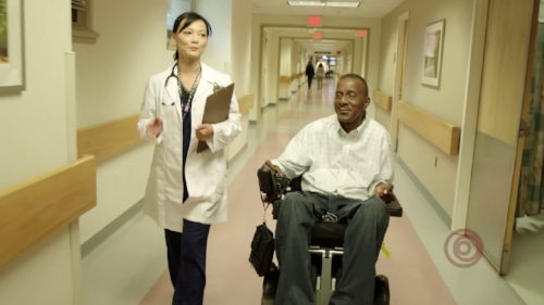 Doctor and patient talking in hospital hallway