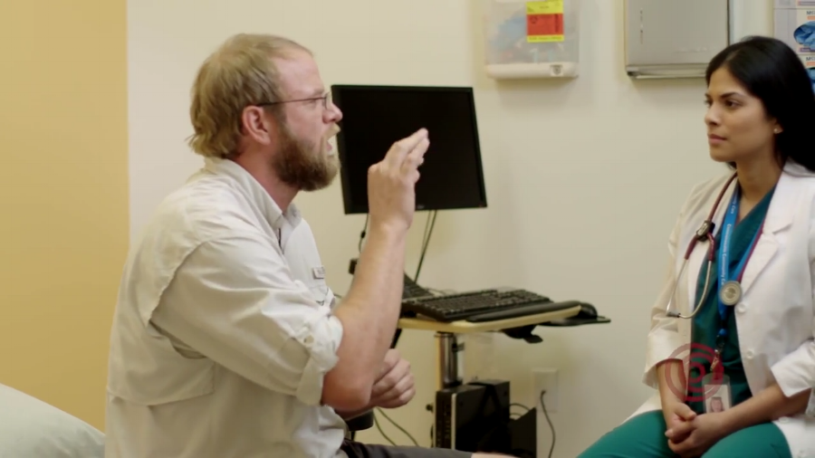 Doctor and deaf patient talking