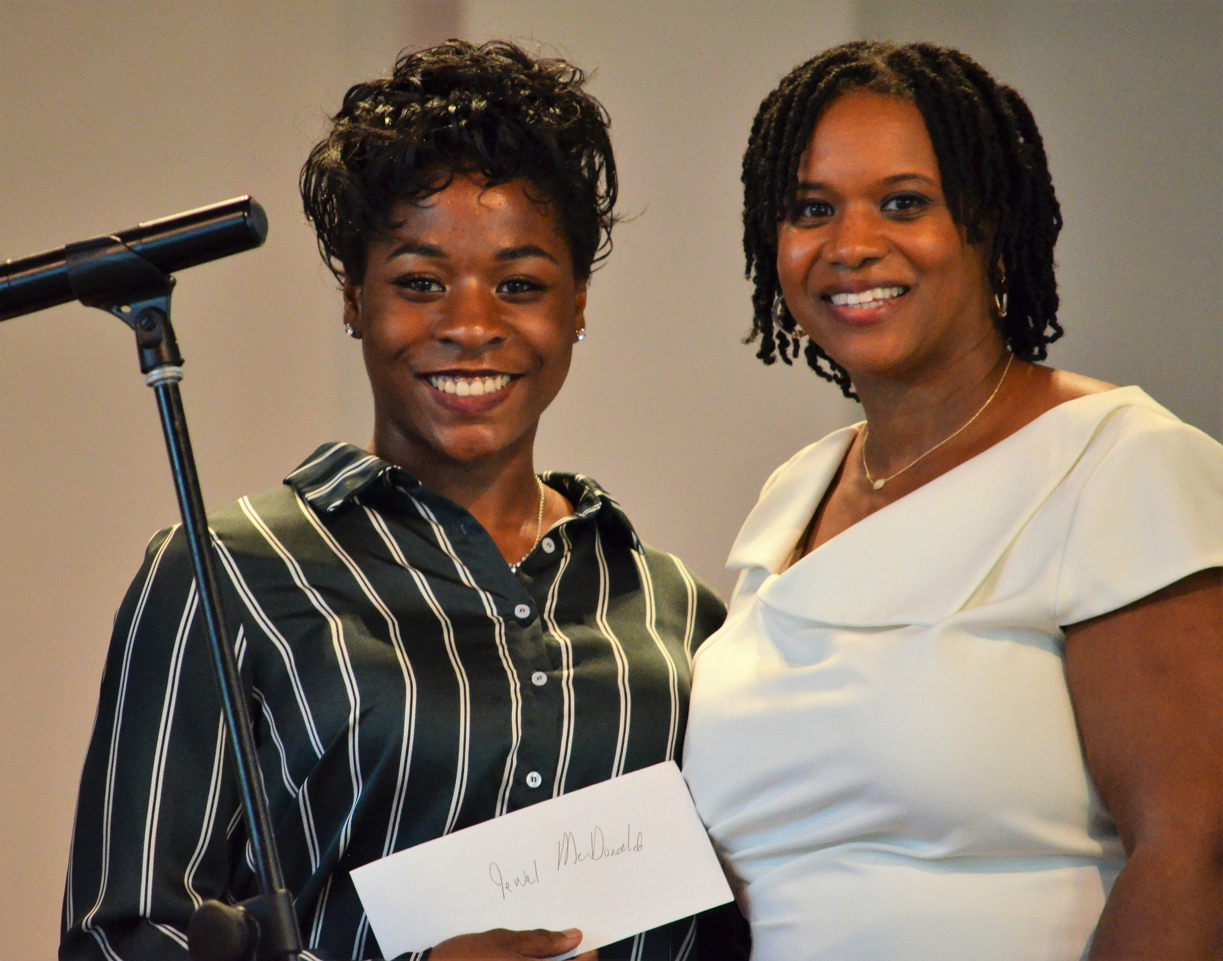 - Jewel McDonald accepts the Dr. Jowava Morrow Book Scholarship Award from Yaminah Leggett-Wells, daughter and family representative of Dr. Jowava Morrow. Jewel is attending North Carolina A&T State University in Greensboro, N.C.