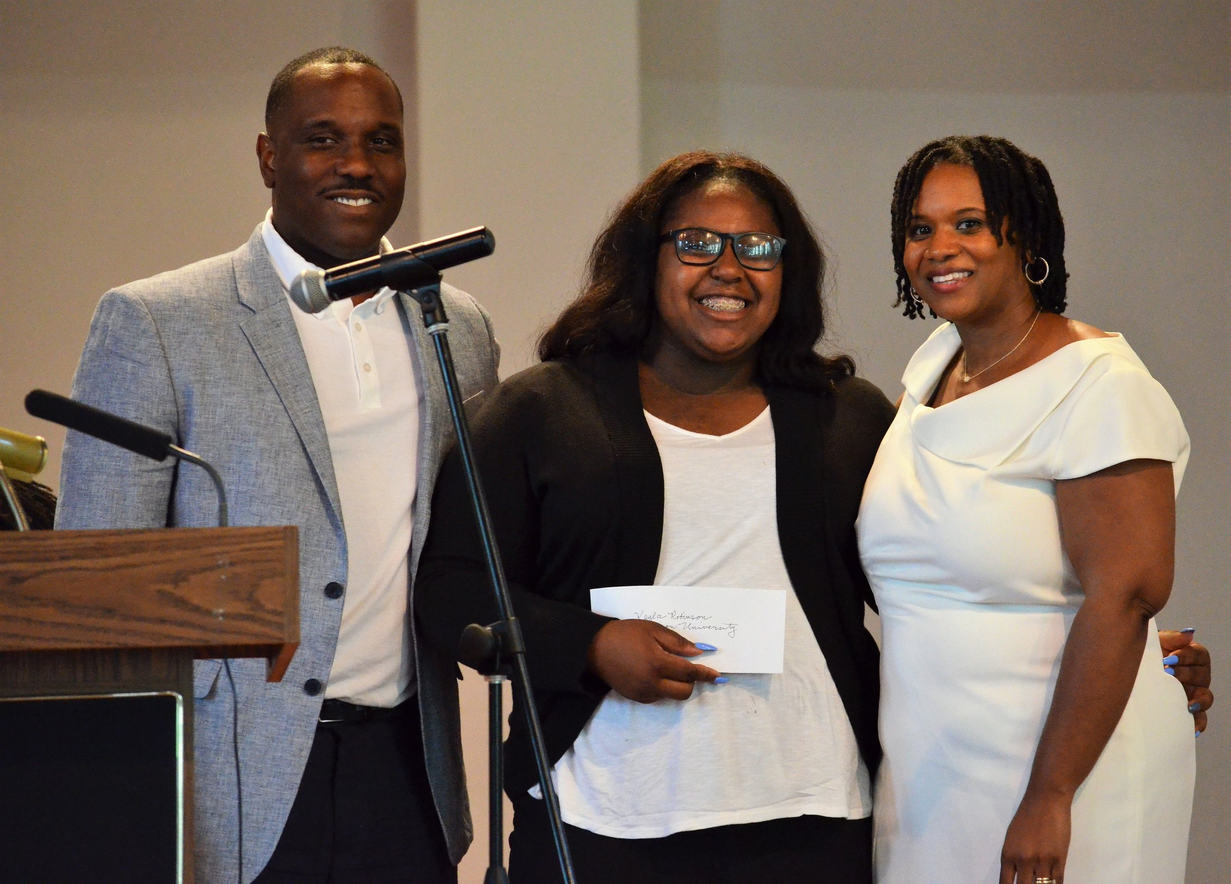 - (Left to right) Kamuzu Saunders, son and family representative of Dr. Jowava Morrow; Kayla Robinson (Dr. Jowava Morrow Book Scholarship Award recipient); and Yaminah Leggett-Wells. Kayla is attending The American University in Washington, D.C.