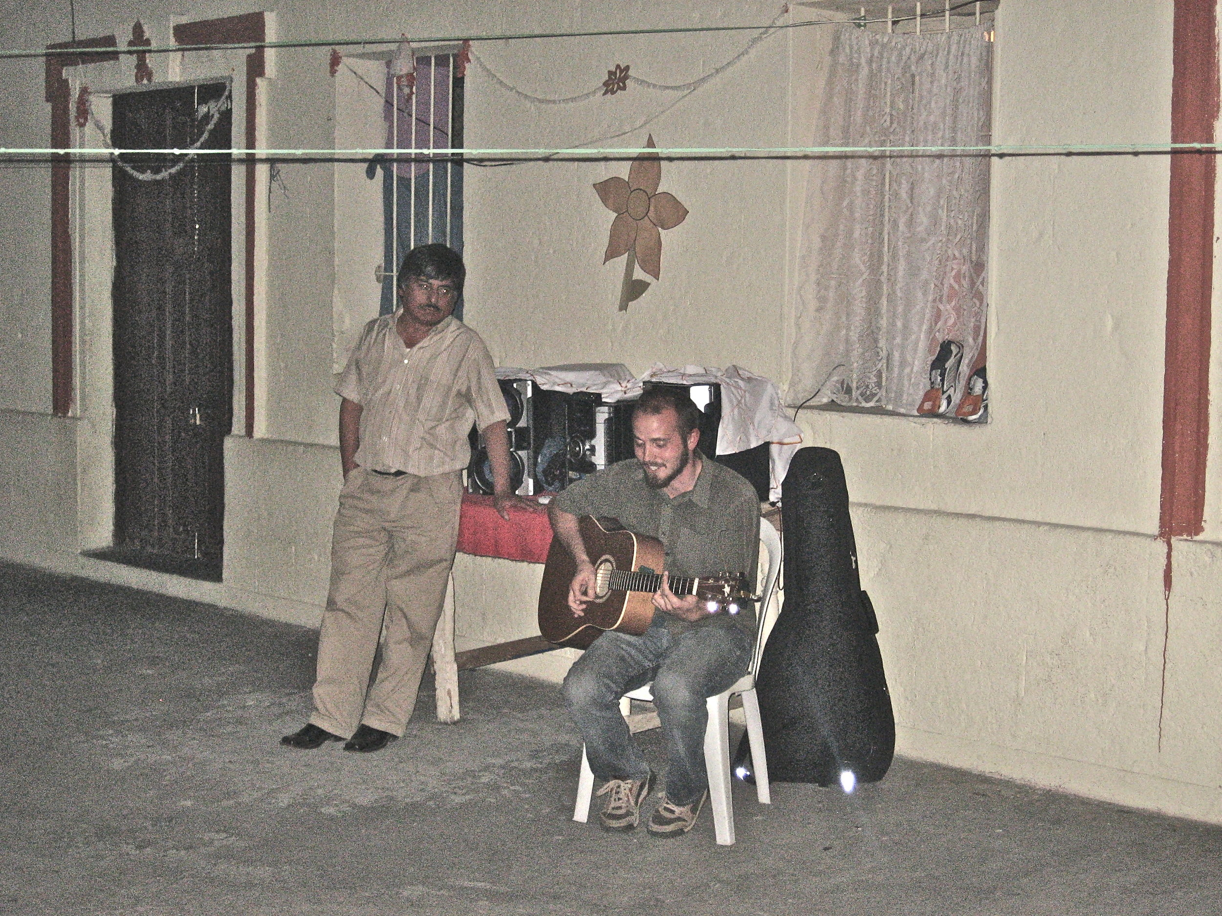 On Christmas Eve, a few hours after I originally sent this email, I went with a few classmates and the director of the school to a Woman's prison in Xela, to spread mirth and positivity. We sang some songs and danced and it was an amazing evening, so much fun was had. The director, pictured here, had me bring my guitar to every event; at the prison, I played a duet with one of the women, who sang the old pub favourite, What's Up, by 4 Non Blondes. What a world.