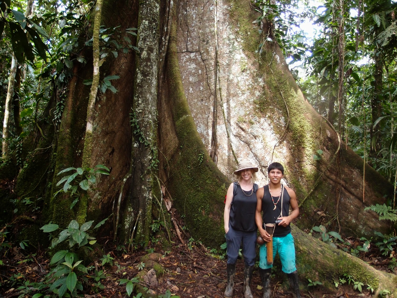 Pegonka and Laura with a ceiba tree in the Huaorani territory of the Amazon rain forest in Ecuador