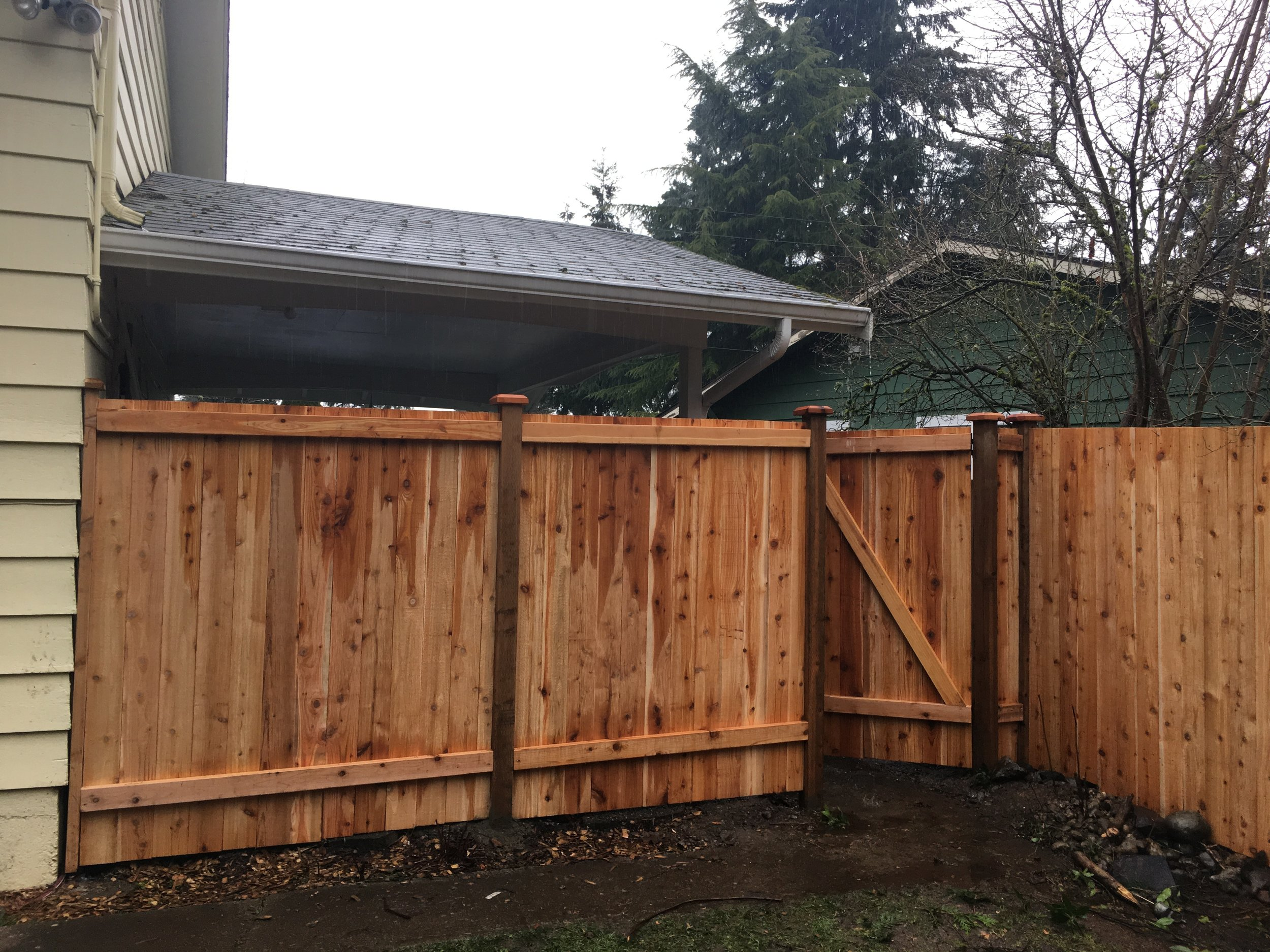 Removed chain link fence and replaced with new cedar fencing