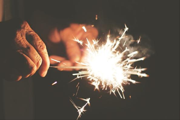 holding birthday sparklers