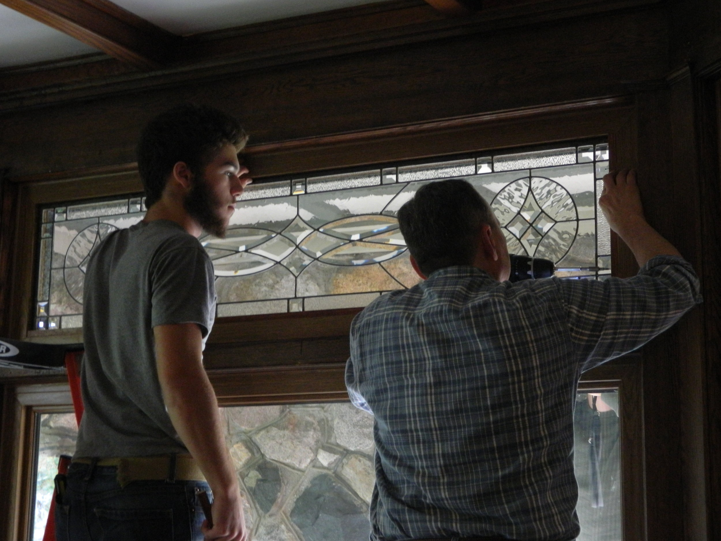 installing new stainglass windows