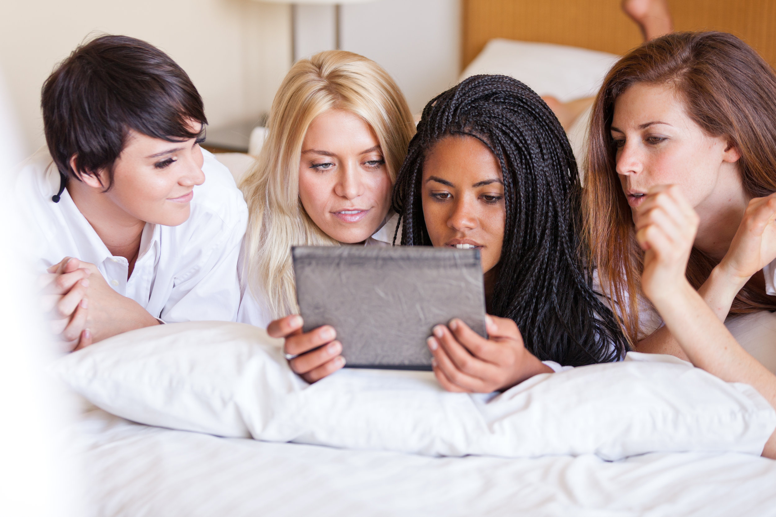Students in hotel bed Shutter 300 dpi.jpg