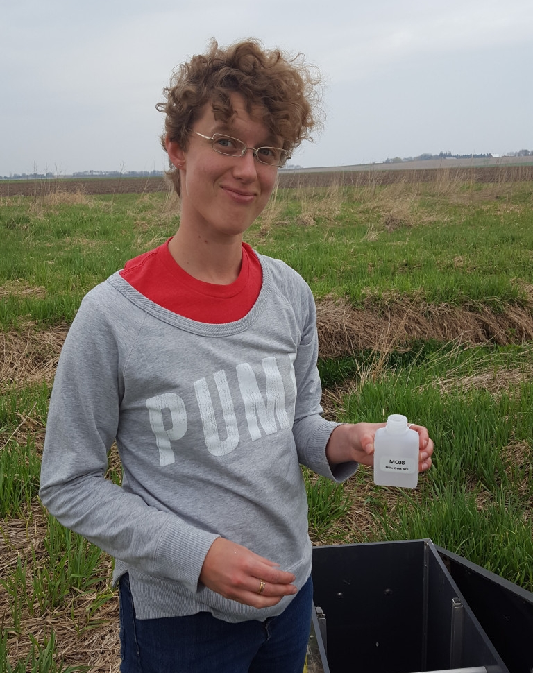 Bri Farber, PhD Candidate at the University of South Carolina, out in the field collecting water samples.