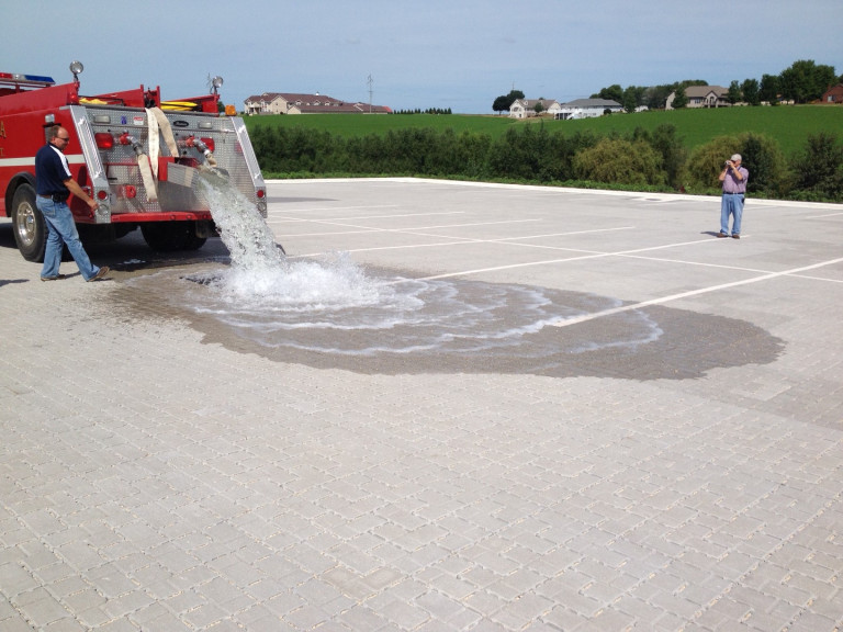 Monona Fire Department's demonstration of the infiltration characteristics of the permeable parking lot. Photo contributed by Eric Palas.