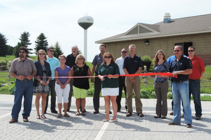 Pictured are some of the participants of the ribbon cutting, including city admininistrator Dan Canton, councilwoman Randee Blietz, watershed planner Ross Evelsizer, deputy clerk Linda Gullickson, Eric Palas with Clayton County SWCD and the Iowa Department of Agriculture and Land Stewardship, swimming pool board member Pam Havlicek, councilman Andrew Meyer, mayor Barb Collins, Tracy Scebold with the Iowa Finance Authority, engineer Jon Biederman, Tiffany Wilson Lillard with the DNR, Corey Bacon of Bacon Concrete (partially hidden), councilman Dan Havlicek and Nick Jensen of Culvers Lawn and Landscape.