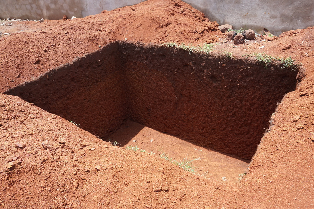 Septic tank is dug and ready to be built with blocks.