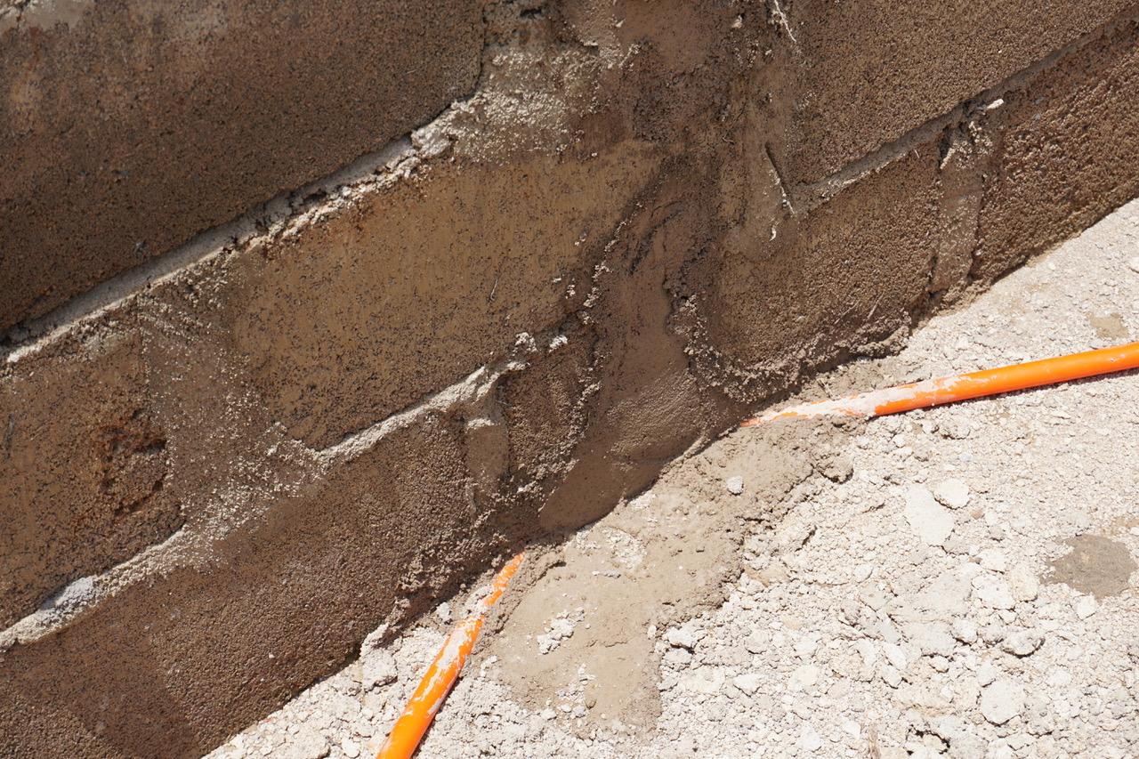 Conduit is ran through a flexible orange hose.