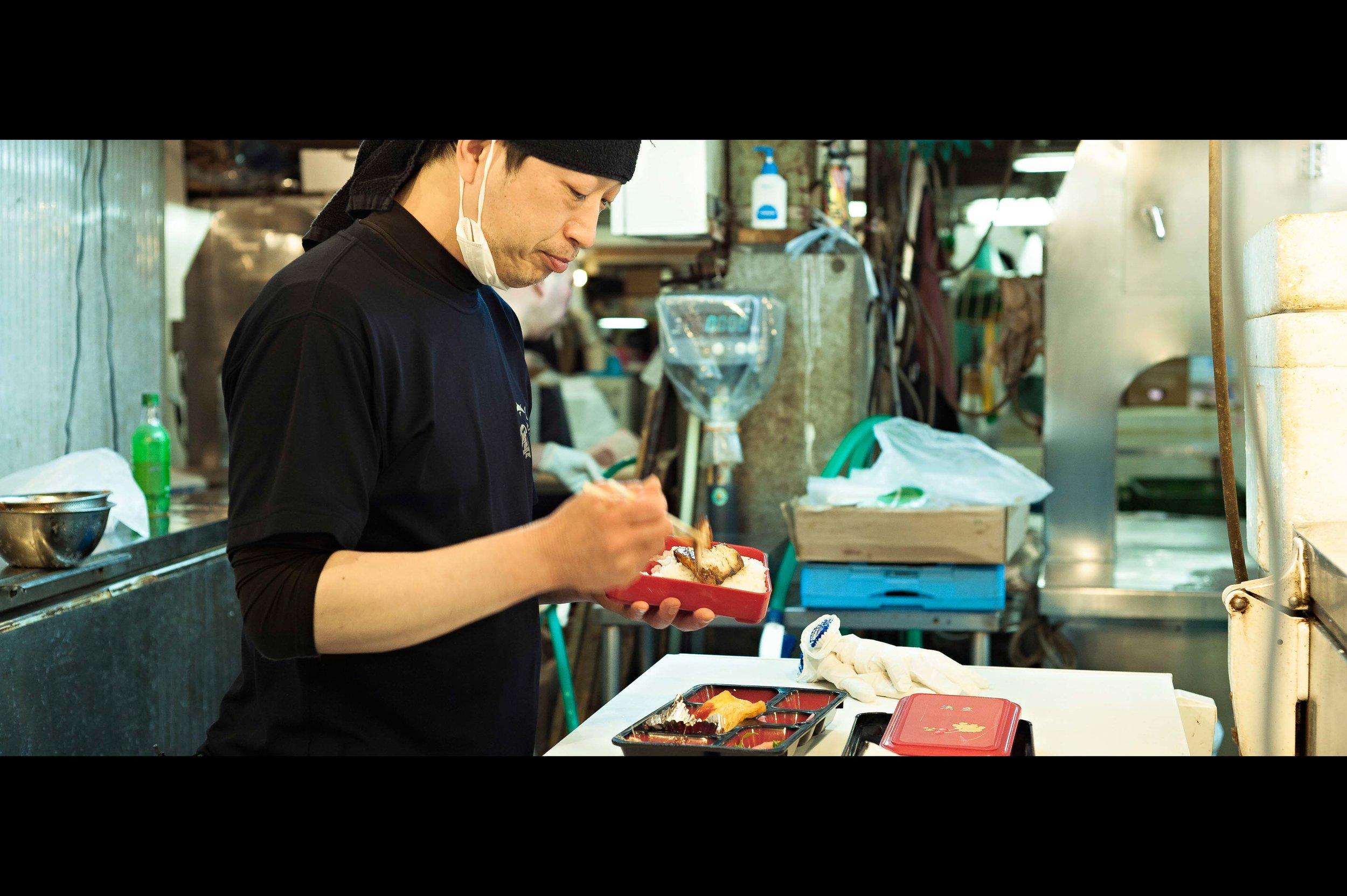 fish-vendor-eating-bento-box.jpg