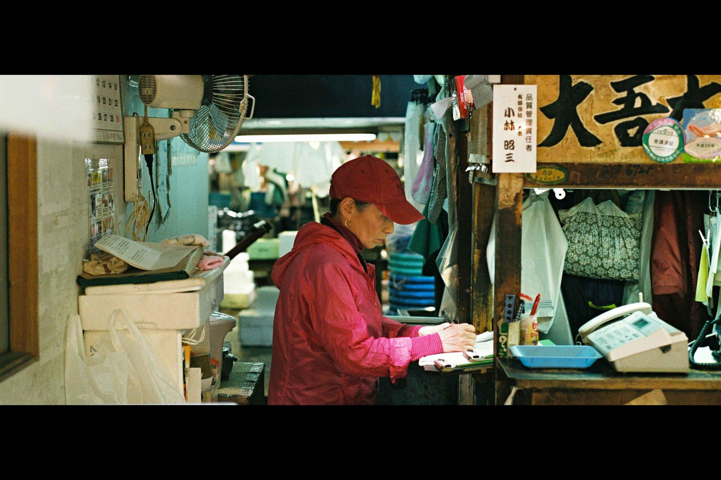 market-woman-ticket-book-keeping.jpg