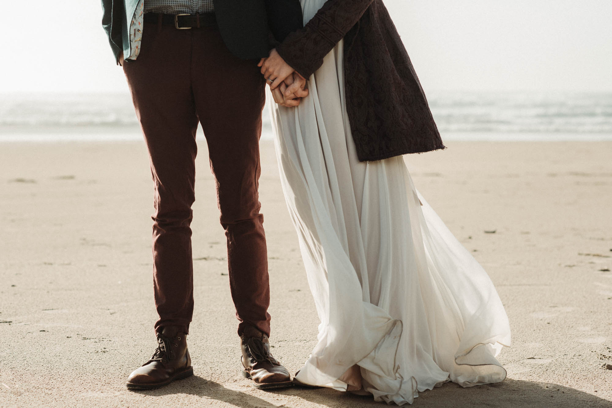 Details for what to wear to as the new mr and mrs to your adventure elopement. The bride is wearing a Truvelle wedding dress.