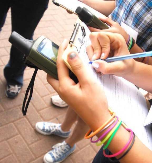 Middle school and high school students learning how to use GPS and collect data during a geocaching treasure hunt in downtown Flagstaff, Arizona. Photo credit:  James Bauerle
