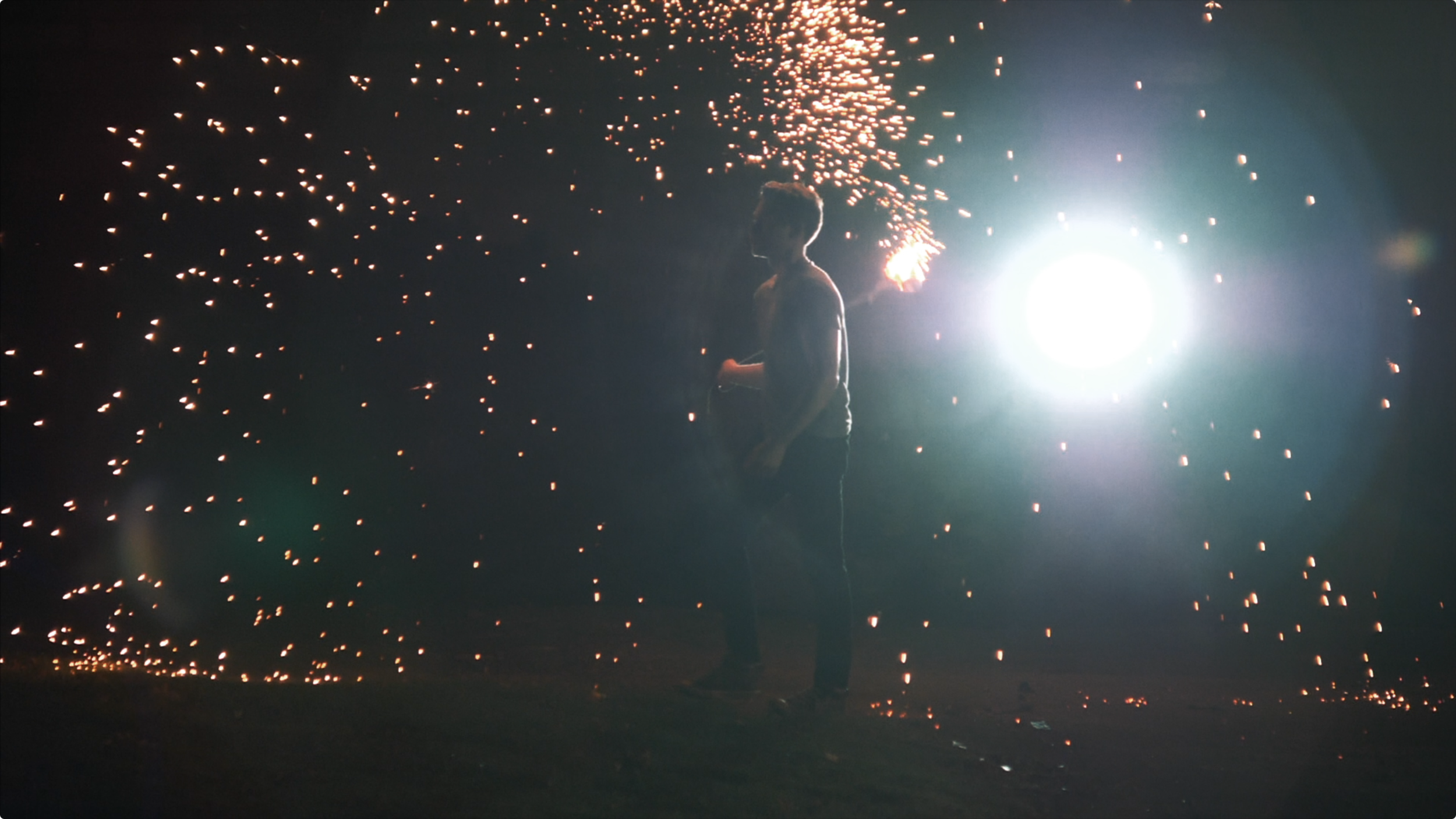 strong backlight photo from our indie music video with steel wool sparkler