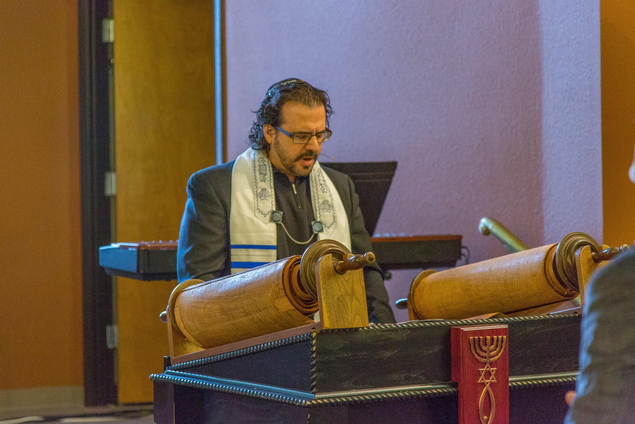 Rabbi Reading Torah.jpg