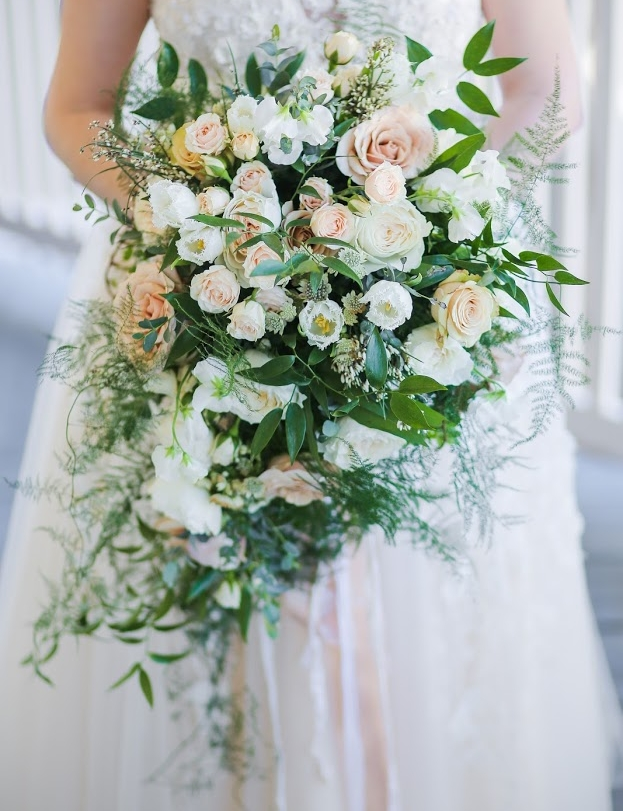 A soft romantic cascading bouquet