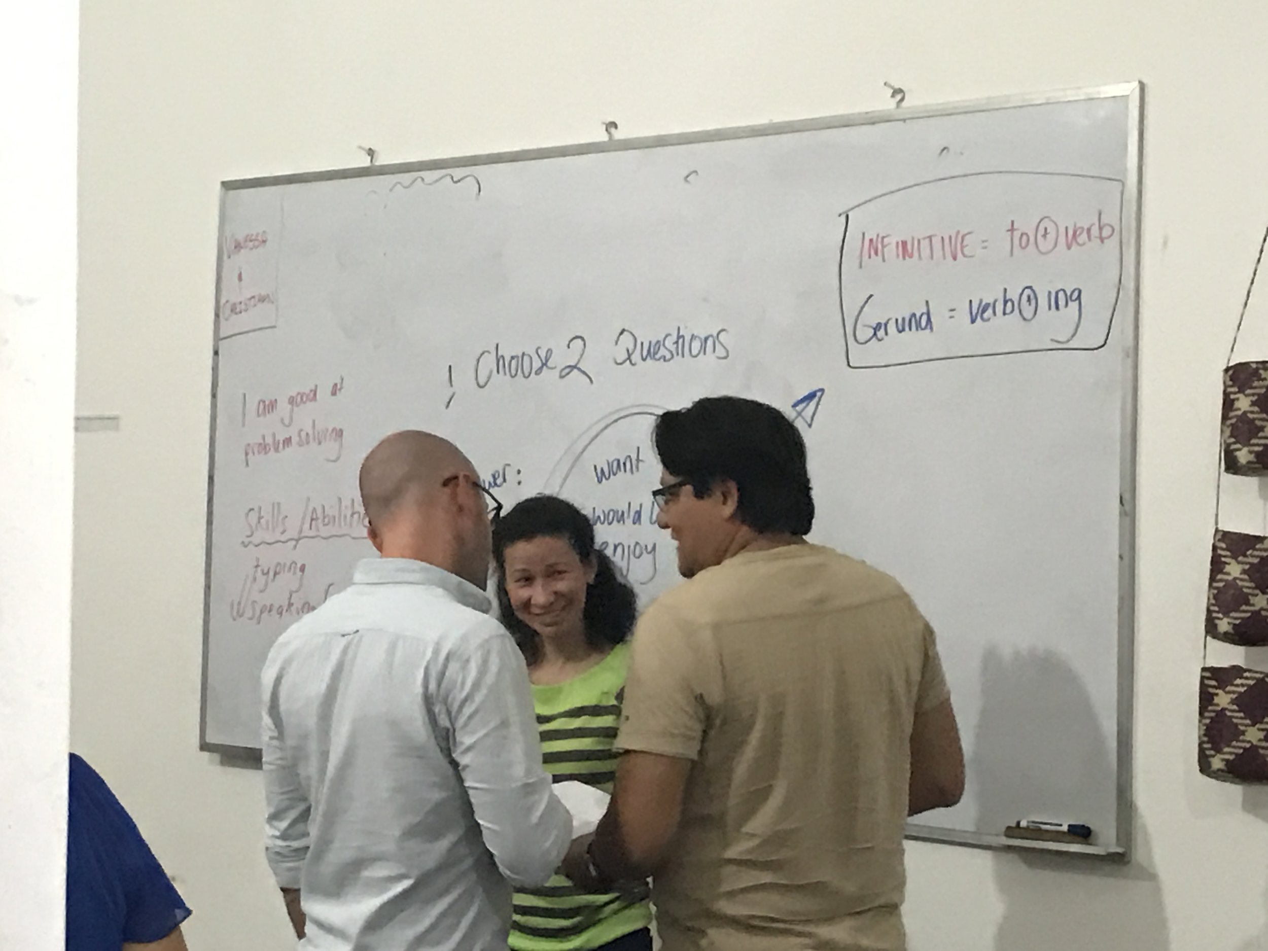 Gilia and Francisco working with their English teacher