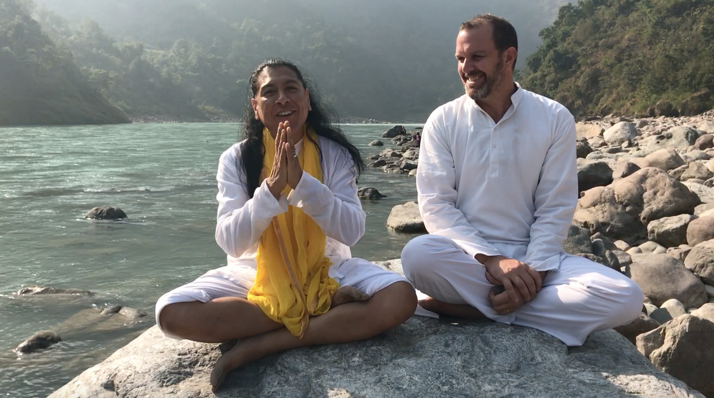 Teachers Don Jose Ruiz and Ramakrishna Ananda giving a satsang (teaching) on the banks of the Ganges in Rishikesh.