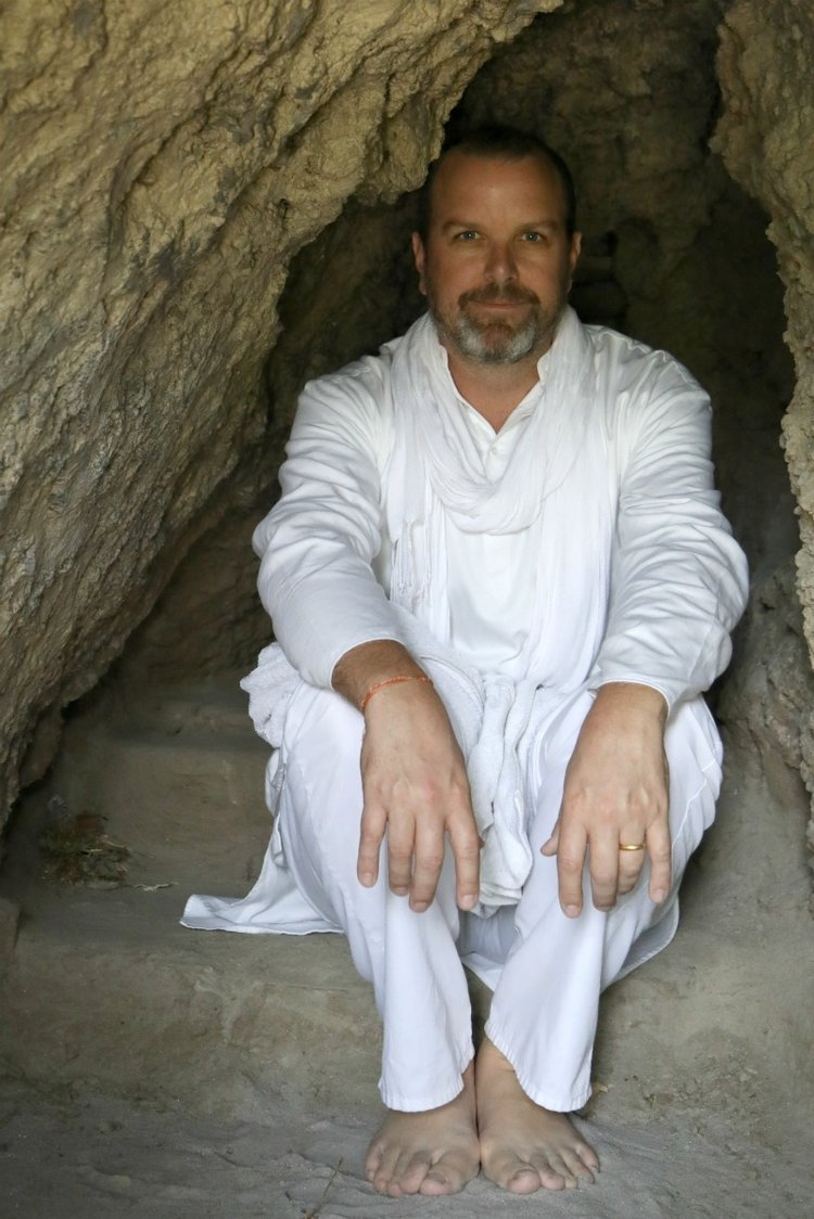 Ramakrishna in caves along the Ganges river in Rishikesh.