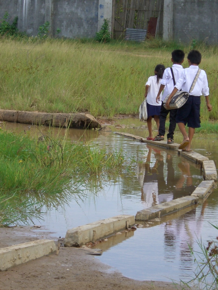 three kids in pp walking on narrow blocks oct 10.jpg