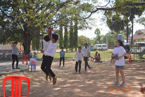 Kids learn ultimate frisbee