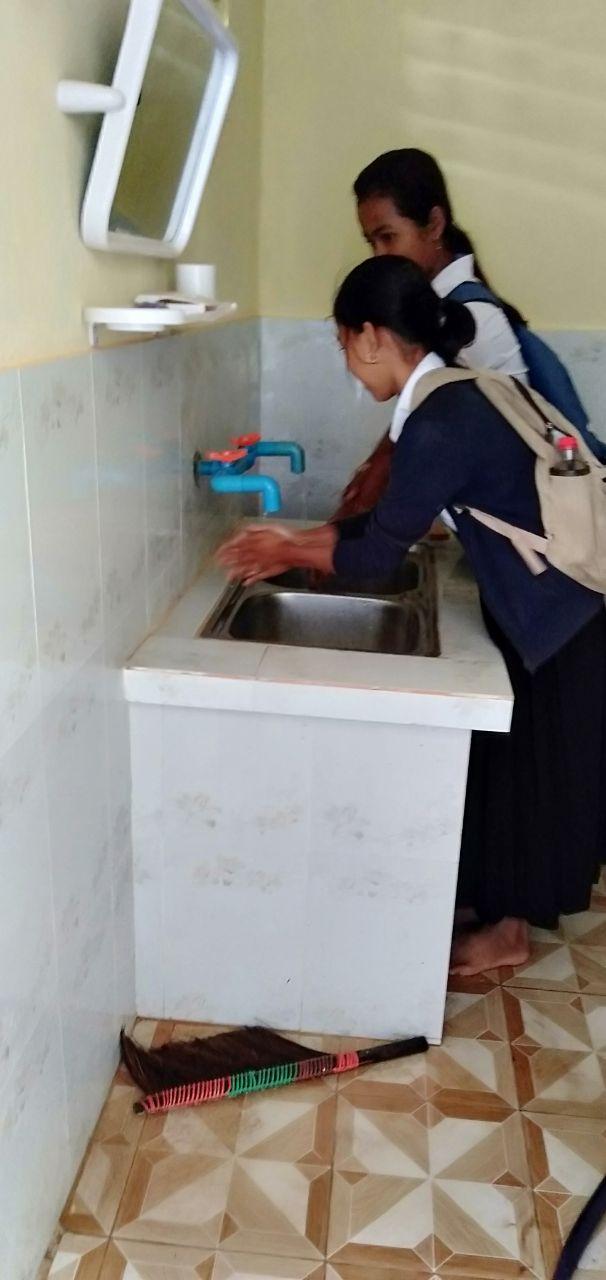 girls using bathroom sink.jpg