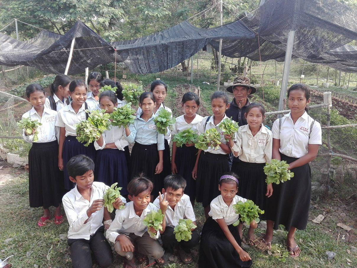 84 kids harvesting.jpg