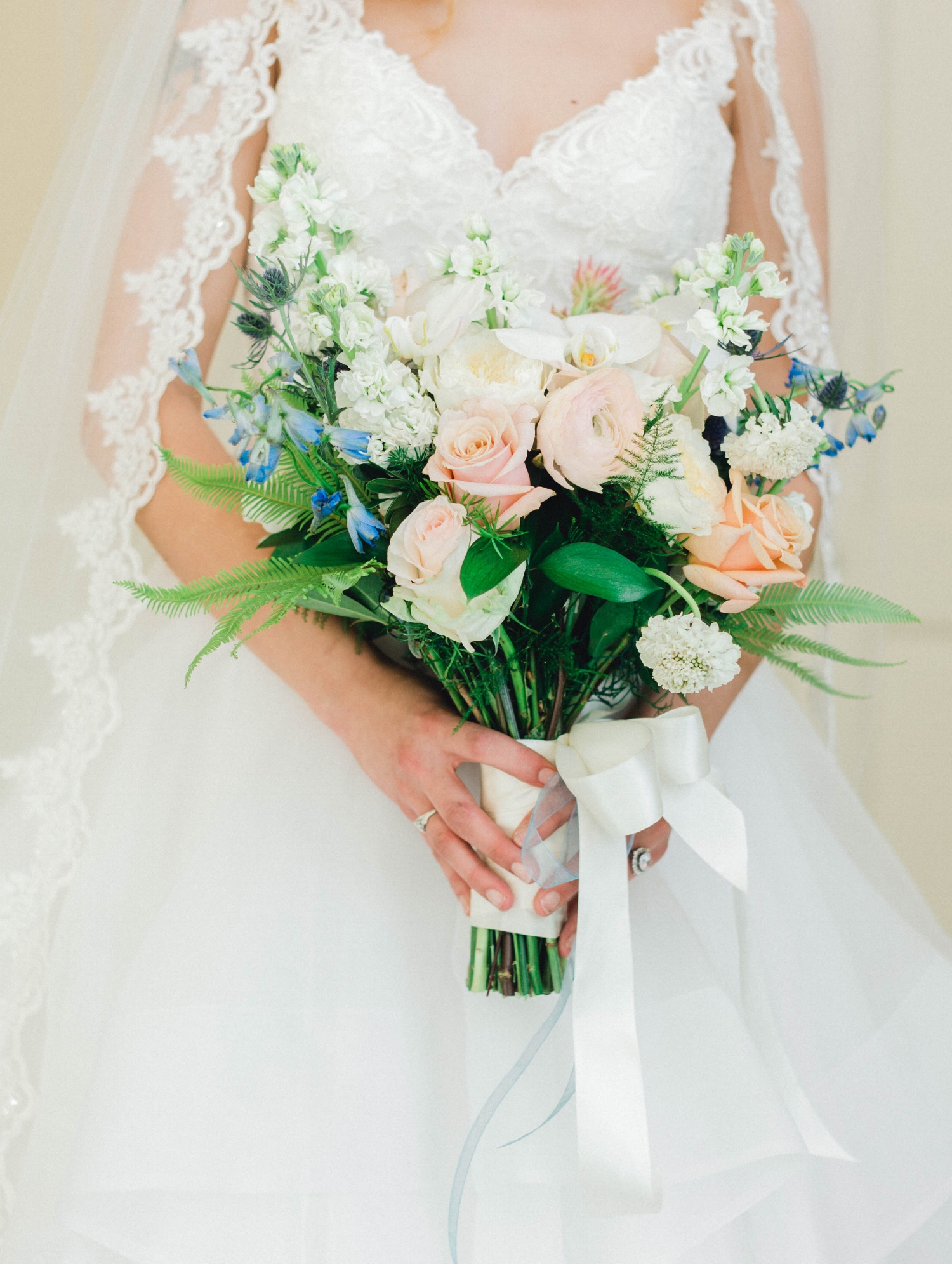 A bridal bouquet of roses at the Duke Mansion in Charlotte, NC