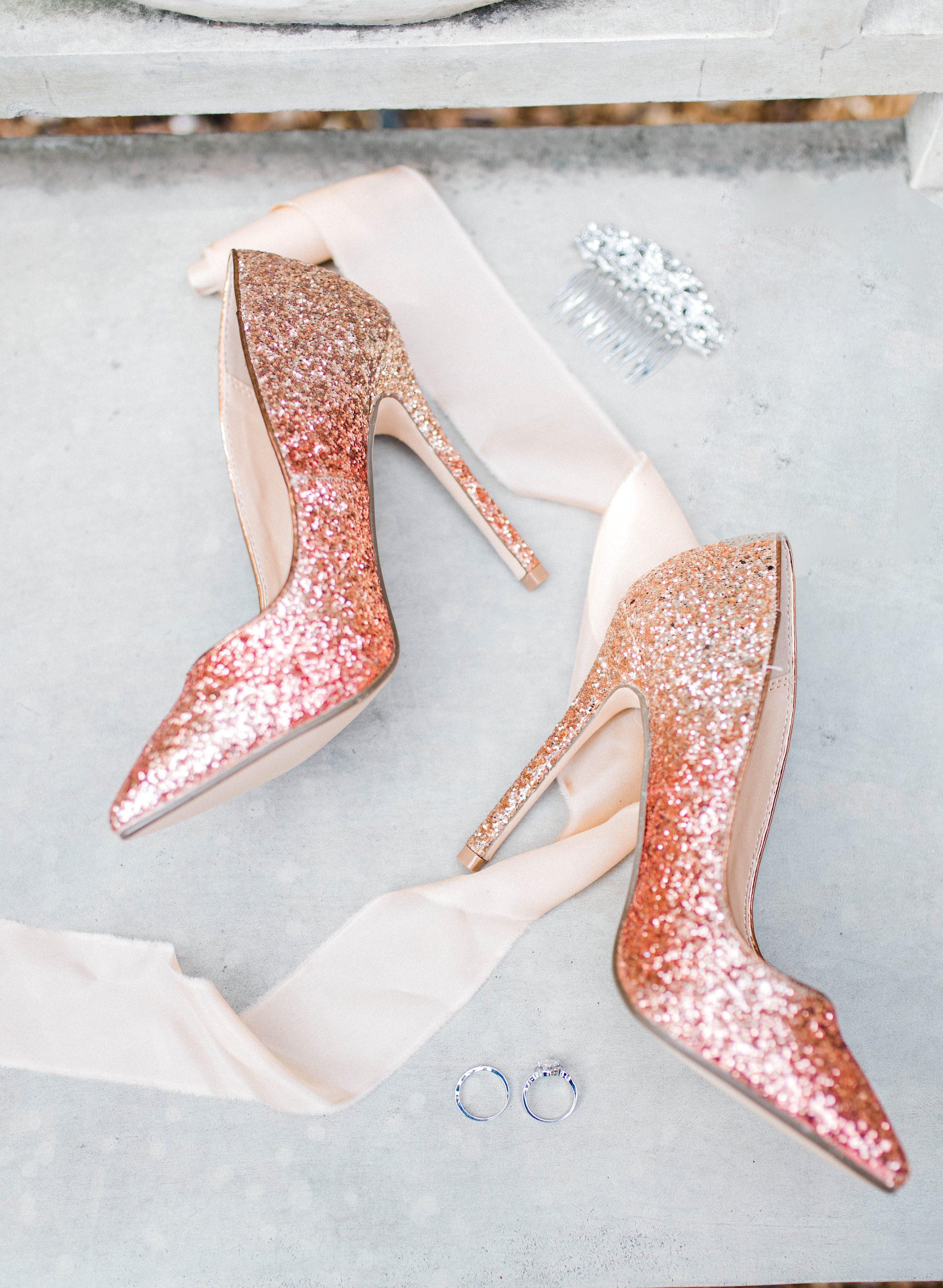 Rose gold wedding shoes and engagement rings by Tierney Riggs Photography