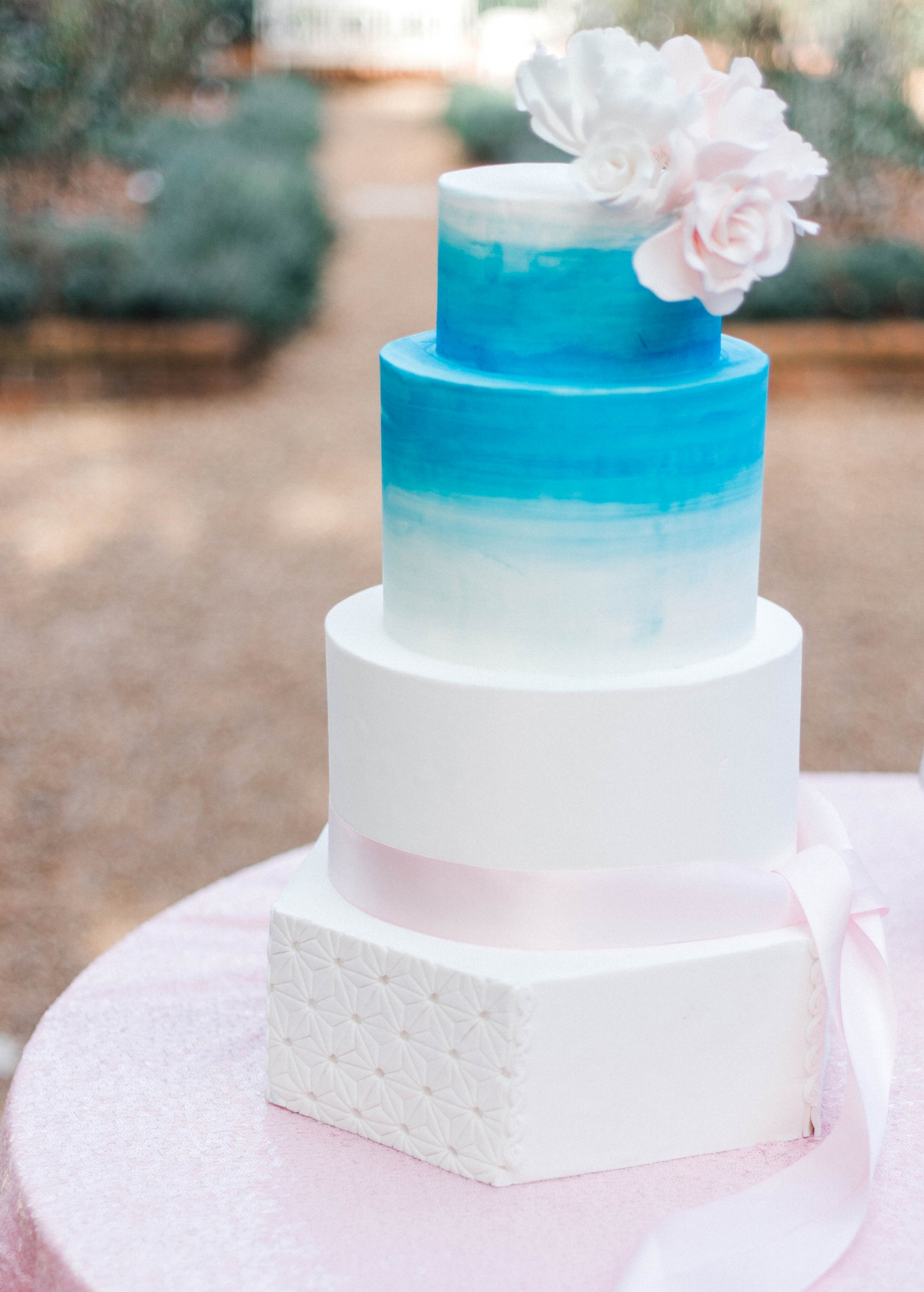 Turquoise and pink wedding cake.
