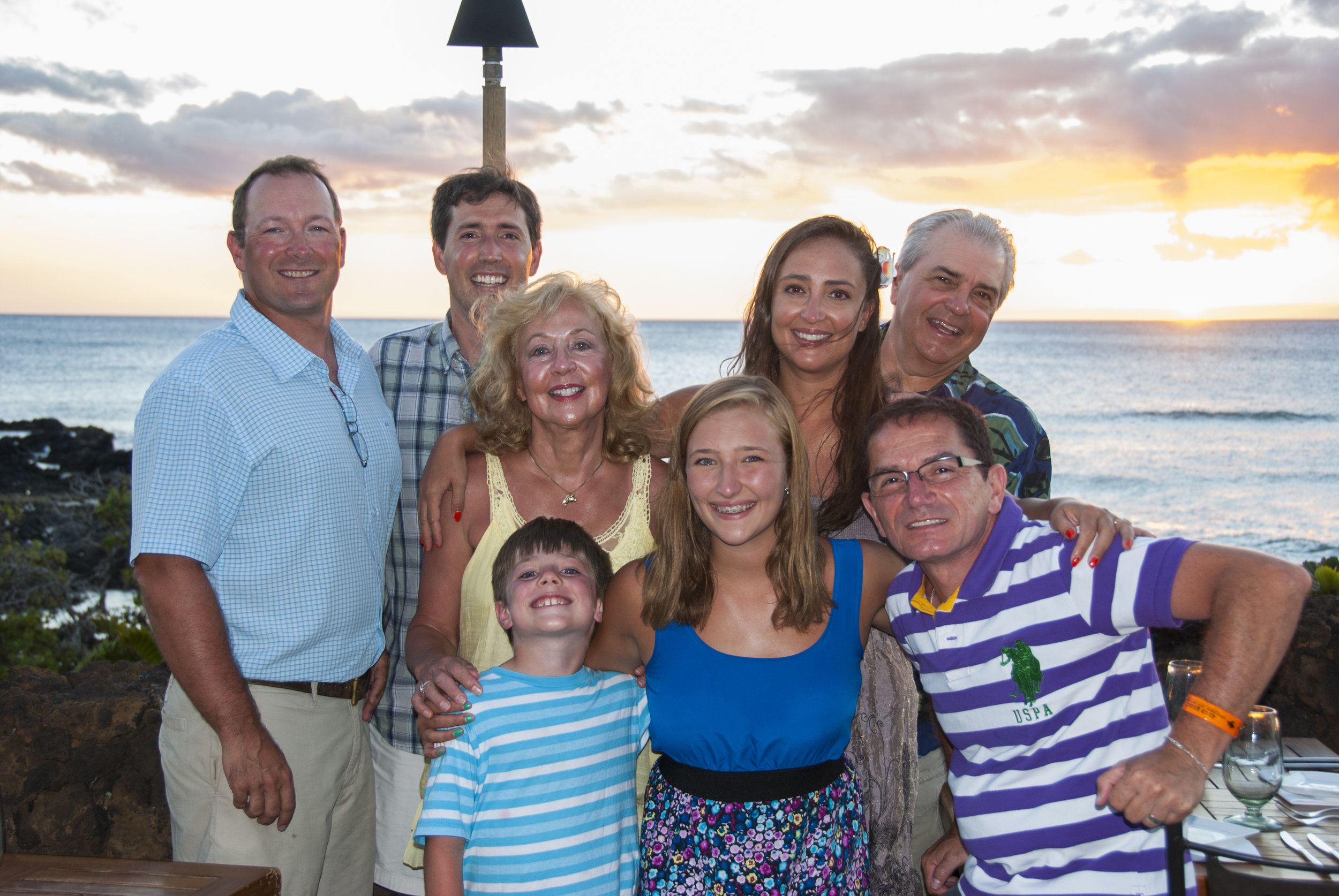 Dave (top right) enjoys traveling with family and friends when his busy schedule allows.