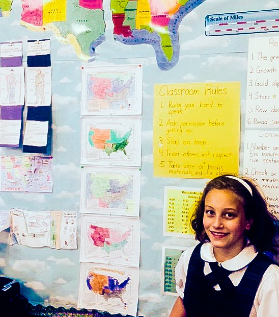 Finishing up the school year, third grade students at St. Monica Academy are proud of their work.