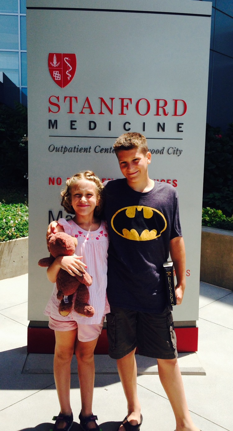 Elliot attended Mathilda's last appointment at Stanford. Always good to take book with you!