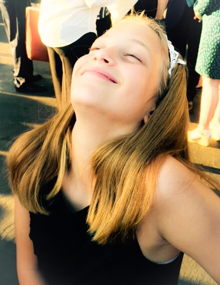 This photo shows how happy Mathilda was at her brother's graduation. It also shows Cataplexy controlled by medication.