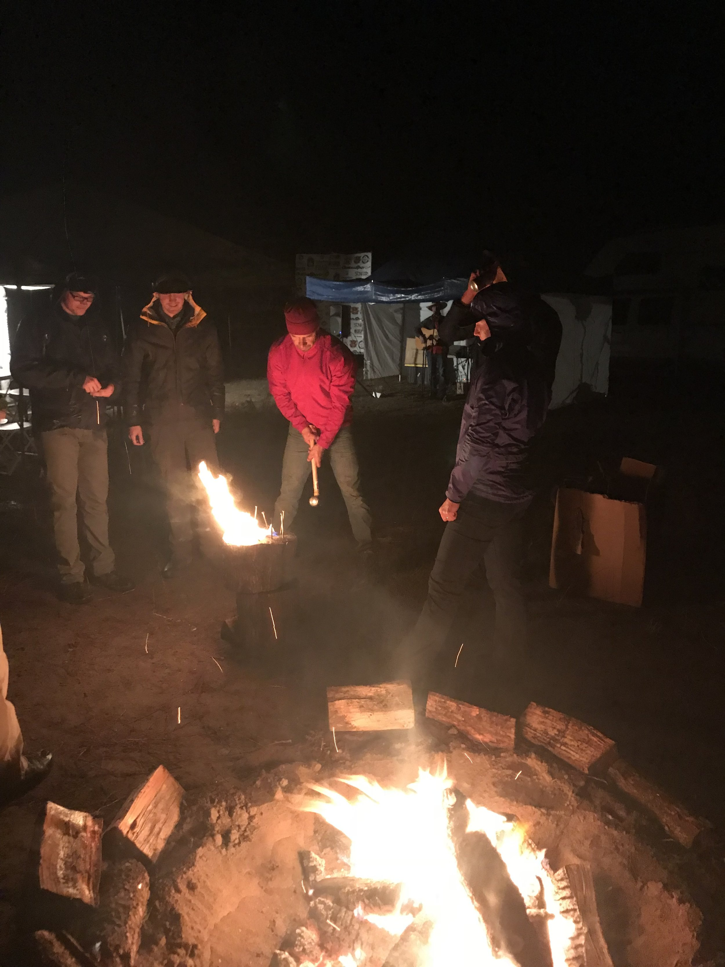 Race Promoter Sam taking a swing at the Fire Log